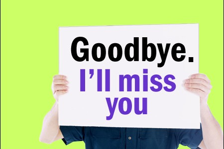 "Man holding sign saying ""Goodbye. I'll miss you"""